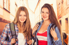 Young pretty girls backpacking Stock Photo
