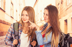 Young pretty girls backpacking Stock Images