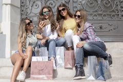 Young and pretty girls with stylish and fashionable shopping bag royalty free stock photo