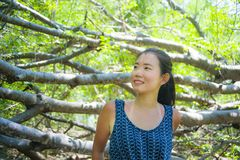 Young pretty and happy Asian Chinese woman taking a walk excursion trip on tropical mountain enjoying nature smiling cheerful in h. Oliday vacation travel and Royalty Free Stock Photography