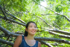 Young pretty and happy Asian Chinese woman taking a walk excursion trip on tropical mountain enjoying nature smiling cheerful in h. Oliday vacation travel and Stock Images