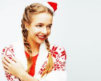Young pretty happy smiling blond woman on christmas in santas re Royalty Free Stock Image