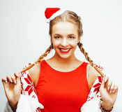 Young pretty happy smiling blond woman on christmas in santas red hat and holiday decorated plaid, lifestyle people Royalty Free Stock Photo