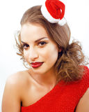 Young pretty happy smiling brunette woman on christmas in santas Stock Images
