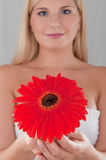 Young pretty healthy woman with red flower Royalty Free Stock Images