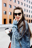 Young pretty hipster girl student with coffee cup posing adorable smiling, lifestyle people concept outdoor. Close up Royalty Free Stock Images