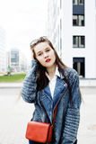 Young pretty hipster girl student with coffee cup posing adorable smiling, lifestyle people concept outdoor. Close up Royalty Free Stock Image