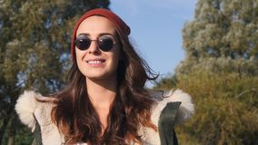 Young pretty hipster mixed race woman in sunglasses smiling and having fun outdoor in sunny day, wearing casual clothes Royalty Free Stock Image
