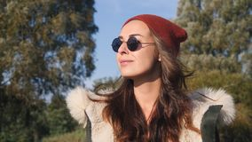 Young pretty hipster mixed race woman in sunglasses smiling and having fun outdoor in sunny day, wearing casual clothes Stock Images