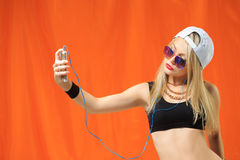 Young pretty hipster woman listening music and Royalty Free Stock Image