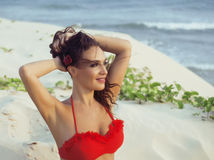 Young pretty hispanic woman on seacoast with flying hair, hot se Royalty Free Stock Images