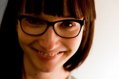 Young pretty and intelligent woman in glasses face portrait. Stock Images