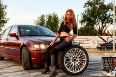 Young pretty lady with a clasic car Stock Photography