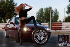 Young pretty lady with a clasic car Royalty Free Stock Photo
