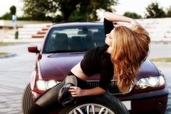 Young pretty lady with a clasic car Royalty Free Stock Image