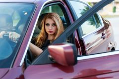 Young pretty lady with a clasic car Stock Images