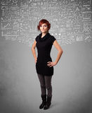 Young pretty lady with hand drawn calculations and icons Stock Photography