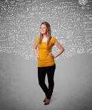 Young pretty lady with hand drawn calculations and icons Royalty Free Stock Images