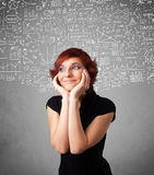 Young pretty lady with hand drawn calculations and icons Royalty Free Stock Photography