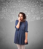 Young pretty lady with hand drawn calculations and icons Royalty Free Stock Image