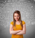 Young pretty lady with hand drawn calculations and icons Royalty Free Stock Photo