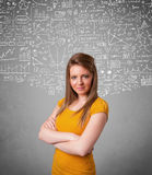 Young pretty lady with hand drawn calculations and icons Stock Image