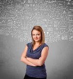 Young pretty lady with hand drawn calculations and icons Stock Photos
