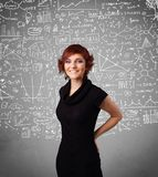 Young pretty lady with hand drawn calculations and icons. Young pretty lady with hand drawn white calculations and icons Stock Photography