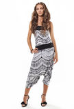 Young pretty lady in harem pants studio portrait Royalty Free Stock Image