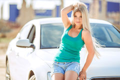 Young pretty lady with a modern luxury car Stock Photo