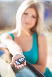 Young pretty lady with a modern luxury car Royalty Free Stock Photography