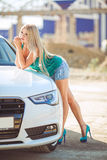 Young pretty lady with a modern luxury car Royalty Free Stock Images