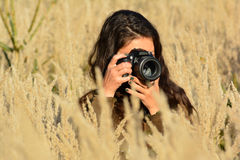 Young, pretty lady photographer Royalty Free Stock Image
