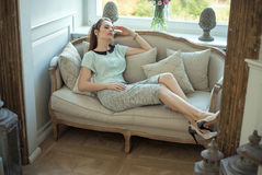 Young pretty lady relaxing at home Stock Photos