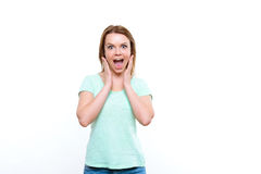 Young pretty lady showing amazement Royalty Free Stock Photography