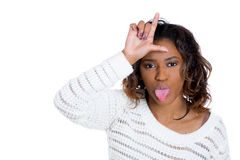 Young pretty lady showing a loser sign , sticking tongue out Stock Image