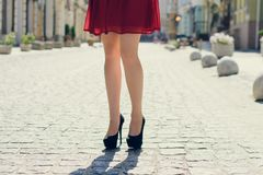 Young pretty lady walking in the city. Close up photo of long wo royalty free stock image