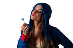 Young Pretty Latino Woman eating a lolly-pop Royalty Free Stock Images