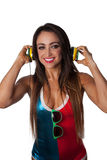 Young Pretty Latino Woman Listening to colorful DJ  Headphones Stock Image