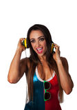 Young Pretty Latino Woman Listening to Headphones. Young Pretty Latino Woman Listening to colorful DJ Style and wearing sunglasses Stock Photography