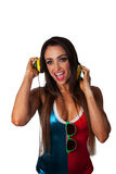 Young Pretty Latino Woman Listening to Headphones. Young Pretty Latino Woman Listening to colorful DJ Style and wearing sunglasses Stock Photo