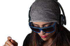 Young Pretty Latino Woman Listening to Headphones. Young Pretty Latino Woman Listening to DJ Style headphones Royalty Free Stock Image