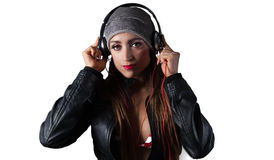 Young Pretty Latino Woman Listening to Headphones. Young Pretty Latino Woman Listening to DJ Style headphones Royalty Free Stock Photos