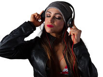 Young Pretty Latino Woman Listening to Headphones. Young Pretty Latino Woman Listening to DJ Style headphones Royalty Free Stock Photo