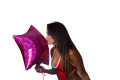 Young Pretty Latino Woman playing with a balloon. Young Pretty Latino Woman playing with a purple balloon Stock Image