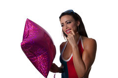 Young Pretty Latino Woman playing with a balloon. Young Pretty Latino Woman playing with a purple balloon Royalty Free Stock Photos