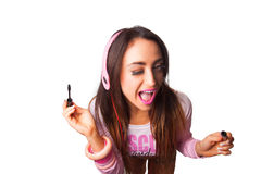 Young Pretty Latino Woman Putting on mascara Stock Photo