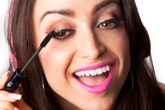 Young Pretty Latino Woman Putting on mascara Royalty Free Stock Image