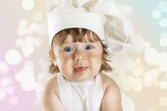 Young and pretty little cook Stock Photo