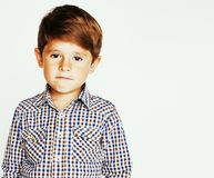 Young pretty little cute boy kid wondering, posing emotional fac. E isolated on white background, gesture happy smiling closeup, lifestyle real people concept stock photo